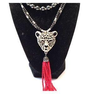 Cheetah head with red tassel